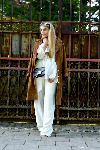Leather Coat, Heels & big Sunnies